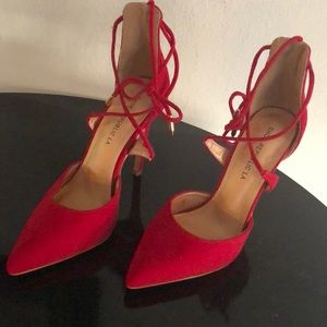 Red strappy pumps